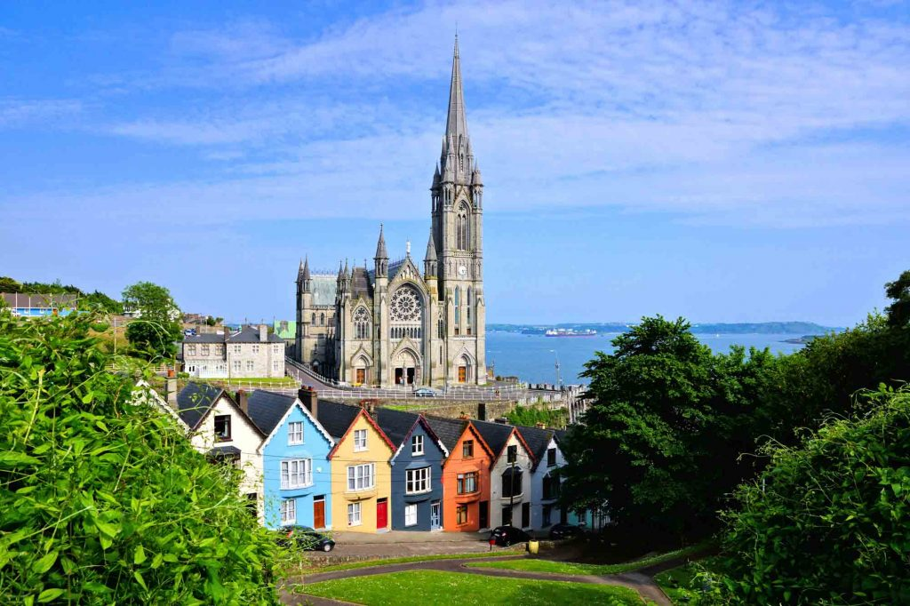 Colorful houses next to Colman Cathedral in Cobh near Cork, Ireland